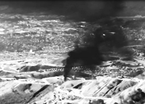A screenshot shows the first aerial infrared video of natural gas spewing from the Aliso Canyon natural gas field in Porter Ranch (Courtesy, Environmental Defense Fund)