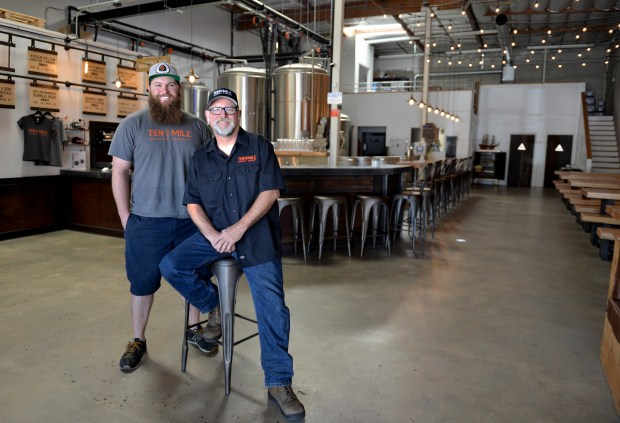 Jesse Sundstorm and his father Dan Sundstorm in their family run business Ten Mile Brewing, recently opened at 1136 E. Willow St., the first of its kind in Signal Hill. Signal Hill October 27, 2017. Photo by Brittany Murray, Press Telegram/SCNG