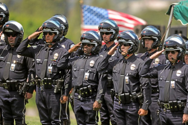 LAPD officers salute at the burial of LAPD officer Chris Cortijo, Tuesday, April 22, 2014, at Forest Lawn Hollywood Hills. (Photo by Michael Owen Baker/L.A. Daily News)