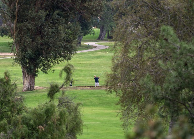 A golfer plays through the course at El Cariso Golf Course in Sylmar on Tuesday, Oct. 31, 2017. (Photo by Ed Crisostomo, Los Angeles Daily News/SCNG)