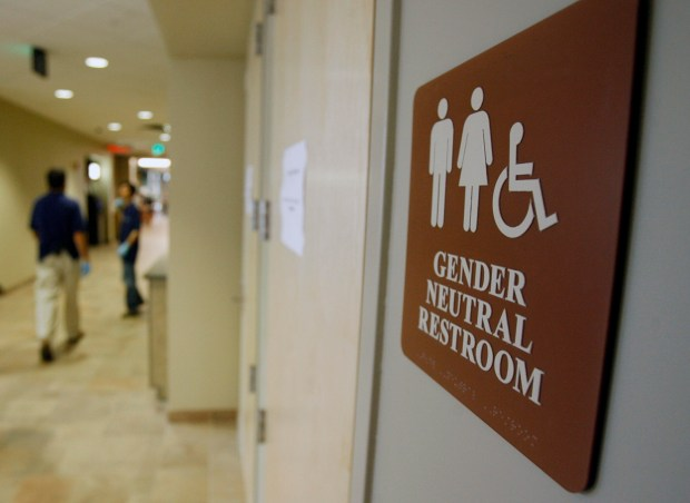 A sign marks the entrance to a gender-neutral restroom at the University of Vermont in this 2007 photo. (AP Photo/Toby Talbot, File)
