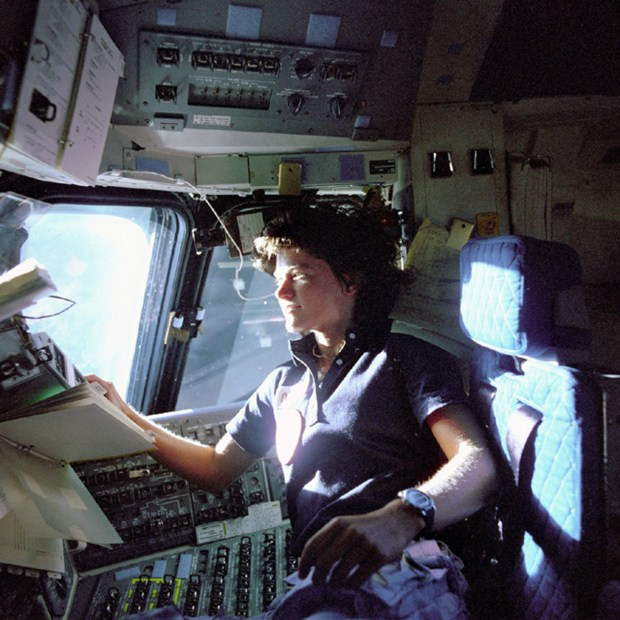 In this June 1983 photo provided by NASA, astronaut Sally Ride, a specialist on shuttle mission STS-7, monitors control panels from the pilot's chair on the shuttle Columbia flight deck. Ride became America's first woman in space when Columbia launched June 18, 1983. (AP Photo/NASA, file)