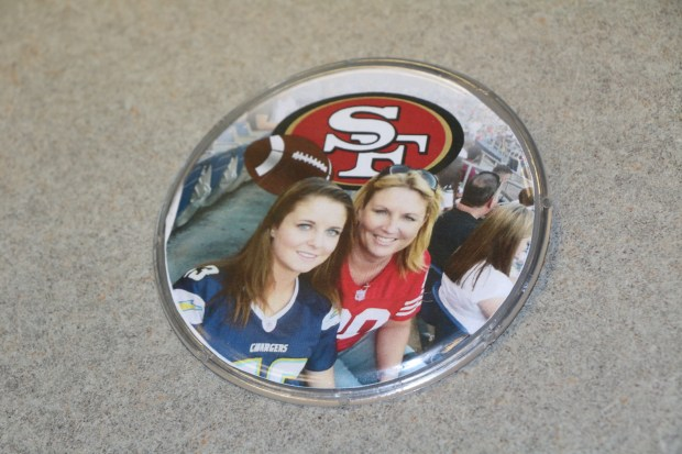 Employees at the San Bernardino County Recorder's Office made this button showing Deputy Recorder Dana Gardner (R), and daughter Kayla Gardner, wearing jerseys of their favorite football teams, the 49ers and Chargers, respectively. Employees wore the button, along with 49ers jerseys, Thursday in honor of Gardner, who was killed in Sunday night's mass shooting in Las Vegas.