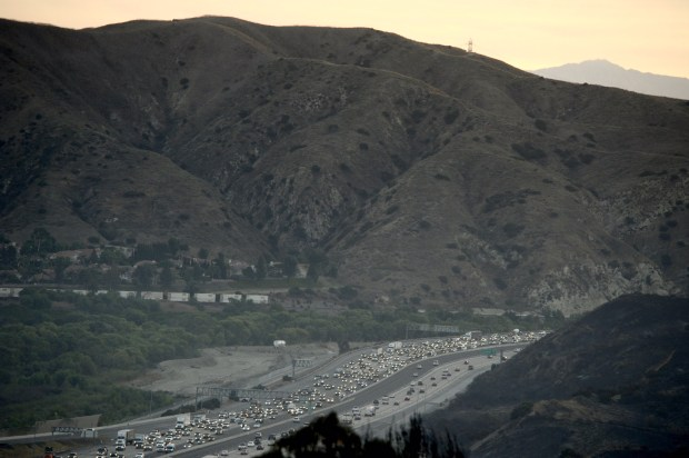 Traffic backs up early Tuesday morning on the 91 westbound coming into Orange County. (Ken Steinhart, Orange County Register/SCNG)