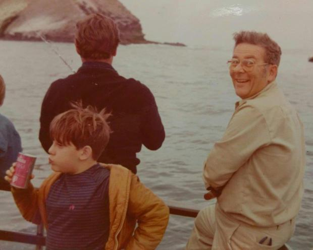 Philip Kassel (R), with youngest son Gregory, during one of the family's many fishing outings.