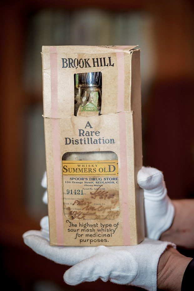 A 1933 prohibition era prescription medicinal bottle of whisky as a part of the historical collection of Redlands history at the AK Smiley Library in Redlands, Sept. 8, 2017. (Eric Reed/For The Redlands Magazine/SCNG)