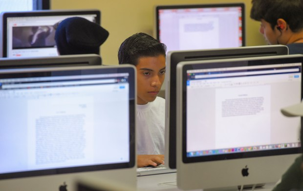 Students quitely work on their projects at the YMCA Youth Institute in Long Beach on Friday, August 4, 2017. Many low-income children fall behind in school because they don't have internet access access at home. Students take advantage of computers and internet access at the YMCA Youth Institute to learn computer skills. (Photo by Scott Varley, Press-Telegram/SCNG)