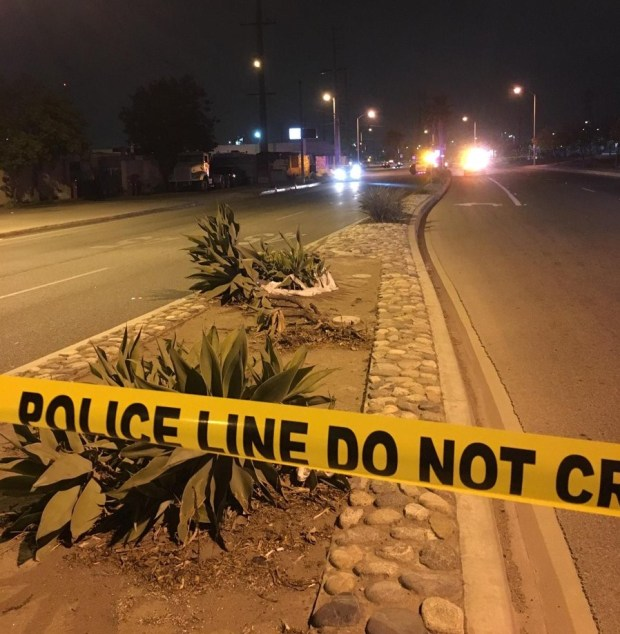 Authorities investigate the scene of an Oct. 19, 2017, shooting that left a man dead in the 1600 block of Arrow Highway in Irwindale.