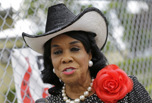 "Rep. Frederica Wilson, D-Fla., talks to reporters, Wednesday, Oct. 18, 2017, in Miami Gardens, Fla. Wilson is standing by her statement that President Donald Trump told Myeshia Johnson, the widow of Sgt. La David Johnson killed in an ambush in Niger, that her husband ""knew what he signed up for."" In a Wednesday morning tweet, Trump said Wilson's description of the call was ""fabricated."" (AP Photo/Alan Diaz)"