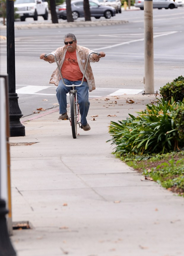 A bicyclist rides on the sidewalk along Valley Mall in El Monte on Thursday, November 2, 2017. In El Monte you cannot ride your bicycle on the sidewalk. (Photo by Keith Durflinger-San Gabriel Valley Tribune/SCNG)