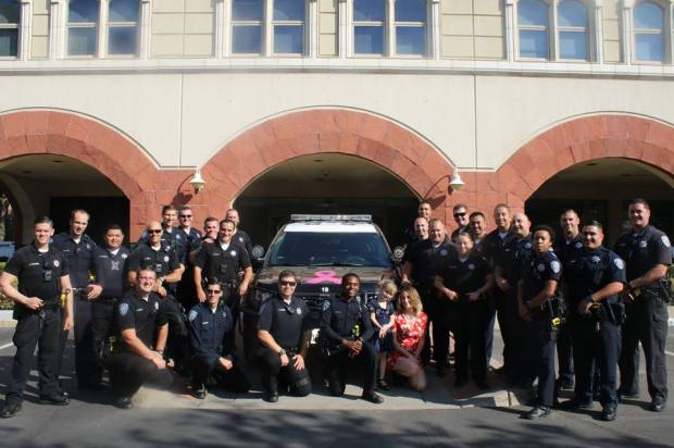 Lilly Bumpus, front, and her mother, Trish Anderson, in red, recently paid a visit to the San Bernardino Police Department. Bumpus and local police officers have developed a strong friendship this past year. (Photo courtesy of San Bernardino Police Department)
