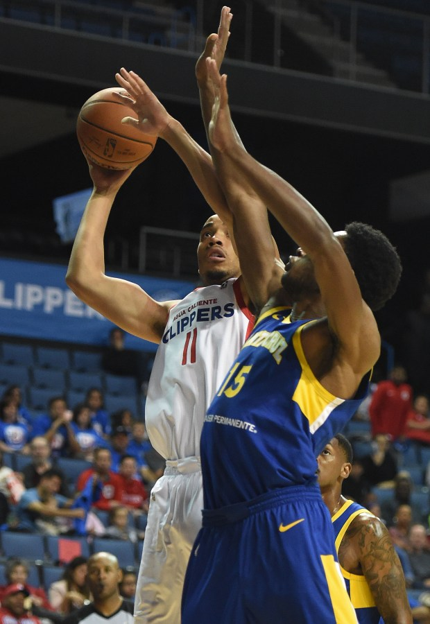 The Clippers Brice Johnson (11) drives to the basket as the Warriors Damian Jones (15) defends during the first half Friday night. Opening night for the Agua Caliente Clippers of Ontario, the NBA team's affiliate in the developmental G-League. The Agua Calientes face the Santa Cruz Warriors in their inaugural home game Friday November 3, 2017 at Citizens Business Bank Arena in Ontario. (Will Lester-Inland Valley Daily Bulletin/SCNG)