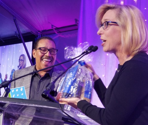 Wendy Greuel presents honoree Herb Wesson with upscale bath salts, highlighting his affection for bubble baths, at the Discovery Cube Los Angeles Inspire Gala, Saturday, Nov. 4. (Photo: Tom Bray/SCNG)