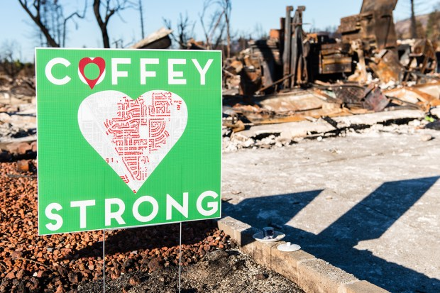 A Coffey Strong sign stands amid the rubble left after the Northern California wildfires. The Coffey Park neighborhood was one of the hardest-hit areas in Santa Rosa. (Heidi de Marco/KHN)