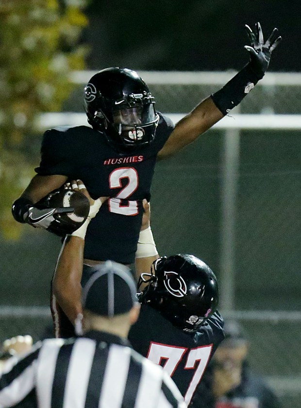 Centennial's running back Thomas Kinslow (2) gets a lift from Centennial's offensive lineman Billy Lutui (77) after his touch down run against Serra in the second half of the Division 1 first-round playoff game Friday in Corona, CA. November 10, 2017. (TERRY PIERSON,THE PRESS-ENTERPRISE/SCNG)