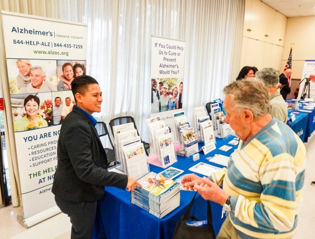 "Kristy Pring, left, an Alzheimer's Orange County outreach intern, speaks with Laguna Woods Village resident Sam Sakansky during the 10th annual ""South County Senior Summit"" at the Laguna Woods Village Clubhouse Three Friday, May 12, 2017. (Photo by Rod Veal, Contributing Photographer)"