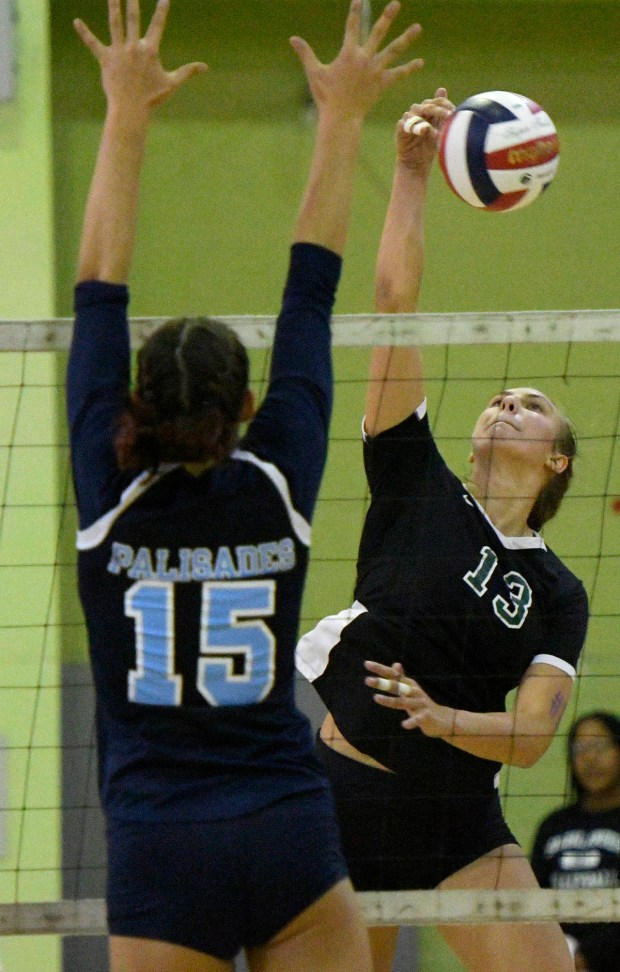 Granada Carissa Bradford#13 spikes the ball past Palisades Alex Laita#15. Granada Hills defeated Palisades in the City Section Open Div volleyball final. Los Angeles,  CA 11/11/2017 (Photo by John McCoy, Los Angeles Daily News/SCNG)
