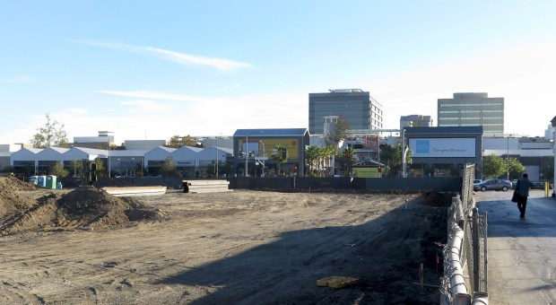 Two new luxury apartment developments, planned for Warner Center in Woodland Hills are making progress. Q West, at 6263 Topanga Canyon Blvd., site of the former Off Broadway shoe store, is across from the The Village at Westfield Topanga. (Photo by Dean Musgrove, Los Angeles Daily News/SCNG)