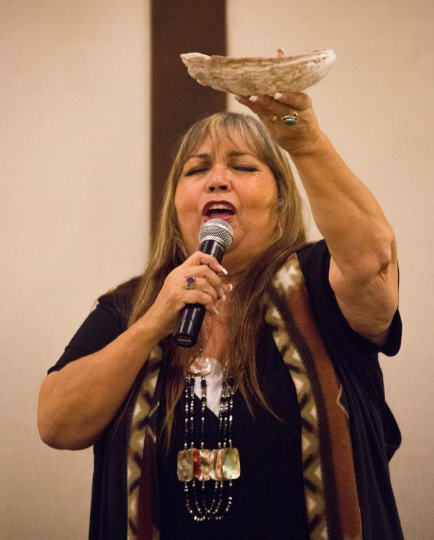 Jacque Tahuka-Nunez offers a blessing and opening prayer at the Native American Heritage Month reception on Nov. 8 at the Fullerton Marriott. (Photo courtesy of Cal State Fullerton)
