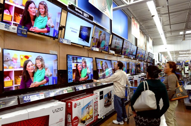 Black Friday is still two weeks away but retailers have already begun with deep discounts including Target, Best Buy. Shoppers look over televisions at Walmart in Rosemead, Calif., Wednesday, Nov. 12, 2014.(Photo by Keith Birmingham/ Pasadena Star-News)