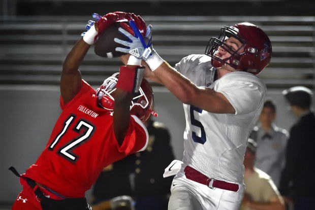 Fullerton's D.J. Irby, left, intercepts a pass in the end zone intended for St. Margaret's Ryan Cragun in the first quarter of their CIF-SS Division 7 playoff football game at Fullerton on Friday Nov. 17, 2017. (Steven Georges, Contributing Photographer)