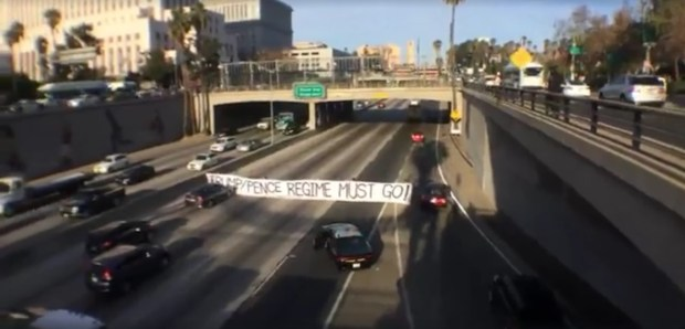 RefuseFascism.org provided this image of protesters unfurling an anti-Trump banner on the 101 Freeway Tuesday, Nov. 21, 2017, in downtown Los Angeles. (Image courtesy of RefuseFacism LA)