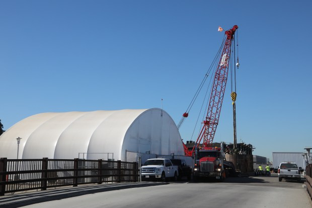 A crane at the site of the tunnel entrance in Hawthorne moves heavy items in and out of the underground structure