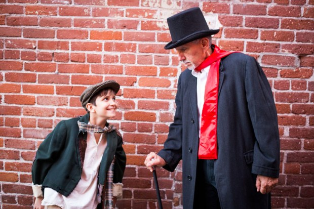 "Jaden Scrima plays Tiny Tim and Nick Diliberto plays Ebenezer Scrooge in LifeHouse Theater's musical ""Scrooge."" (Photo by Elizabeth Ekema-Nardella)"
