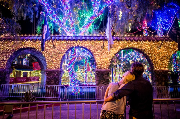 Garrett Powell, of San Clemente, and Jennifer Thayer, of Dana Point, admire lights during 25th annual Festival of Lights switch-on ceremony at The Mission Inn Hotel & Spa in Riverside on Friday, Nov. 24, 2017. (Photo by Watchara Phomicinda, The Press-Enterprise/SCNG)