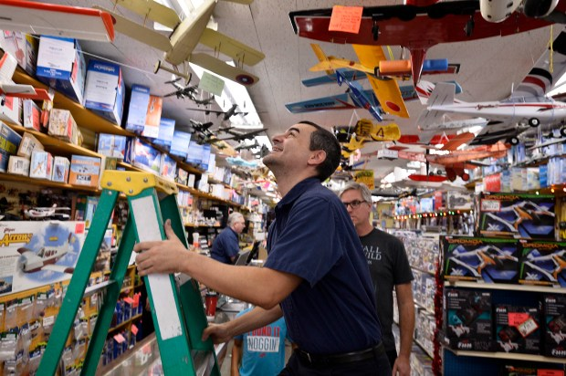 "Jason Eminian climbs a ladder to get a model airplane for a customer. Eminian is the owner of Smith Brothers Hobby Center. Linda McMahon, Administrator of the U.S. Small Business Administration, is reminding Americans that shopping on Small Business Saturday supports America's thriving small businesses. ""Small Business Saturday is about supporting local businesses and creating jobs in communities all across America,"" said McMahon. ""Shopping small this Saturday is the perfect opportunity for Americans to support their local community businesses and promote growth and vitality to America's booming economy during this holiday season and throughout the coming year."" Northridge, CA 11/25/2017 (Photo by John McCoy, Los Angeles Daily News/SCNG)"