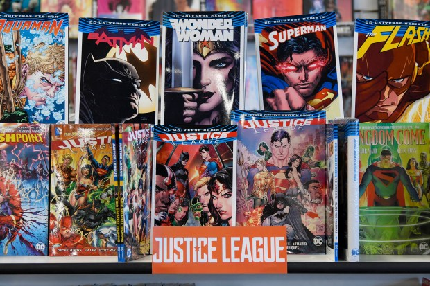 """Justice League comics at Collector's Paradise. Linda McMahon, Administrator of the U.S. Small Business Administration, is reminding Americans that shopping on Small Business Saturday supports America's thriving small businesses.""""Small Business Saturday is about supporting local businesses and creating jobs in communities all across America,"""" said McMahon. """"Shopping small this Saturday is the perfect opportunity for Americans to support their local community businesses and promote growth and vitality to America's booming economy during this holiday season and throughout the coming year."""" Northridge, CA 11/25/2017 (Photo by John McCoy, Los Angeles Daily News/SCNG)"""