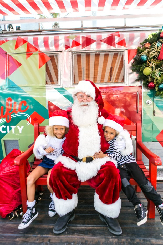 A skydiving Santa Claus made a unique entry to the Pacific City mall in Huntington Beach, by landing on the sand across from the shopping area. The visit, on Saturday, Nov. 18, officially kicked off the holiday season at the venue. (Photo courtesy Pacific City)