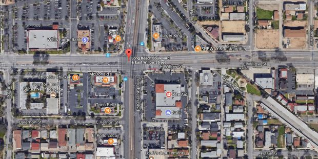 A man with a knife who was fleeing Long Beach police late Sunday, Nov. 19, 2017, at the Metro Blue Line station at Long Beach Boulevard and Willow Street was struck by a hit-and-run driver. (Google Maps)