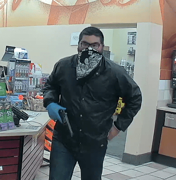"Police are looking for a gunman who robbed a Placentia gas station Monday, Nov. 13. ""Photo courtesy of Placentia Police Department"