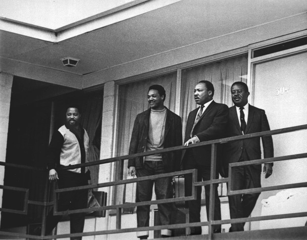 File - The Rev. Martin Luther King Jr. stands with other civil rights leaders on the balcony of the Lorraine Motel in Memphis, Tenn., on April 3, 1968, a day before he was assassinated at approximately the same place. From left are Hosea Williams, Jesse Jackson, King, and Ralph Abernathy. (AP Photo/Charles Kelly)