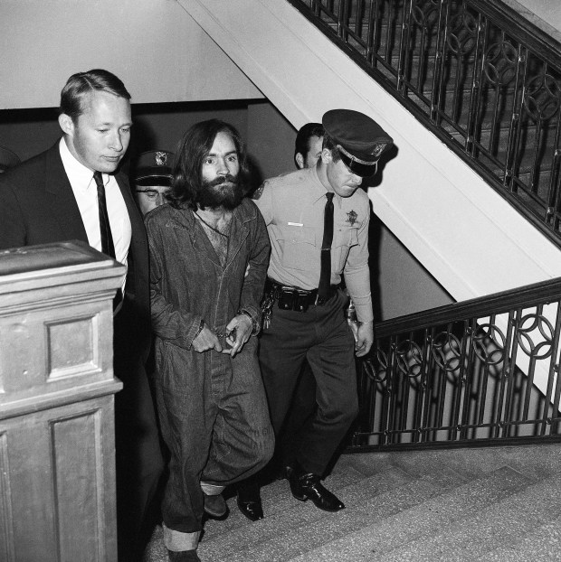 "Charles M. Manson, 35-year-old bearded leader of a communal clan he called ""the family"" is shown as he arrived in Los Angeles, Dec. 10, 1969, to be jailed on murder-conspiracy charges in the deaths of actress Sharon Tate and six others. (AP Photo/Harold P. Matosian)"