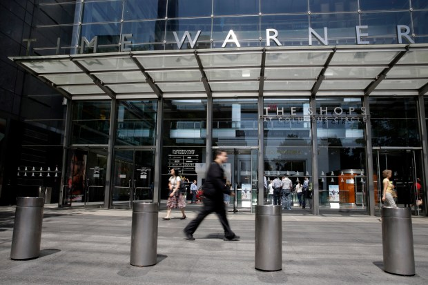 "AT&T now says it's ""uncertain"" when its $85 billion Time Warner purchase will close. AT&T had maintained that the deal would be done by the end of 2017. (AP Photo/Mary Altaffer, File)"