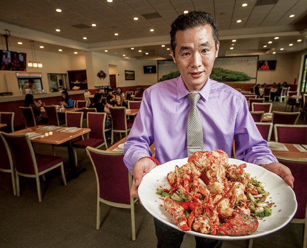 Eddy Sum with the Fried Lobster Plate at Big Sky Restaurant in Riverside. Eric Reed/Riverside Magazine