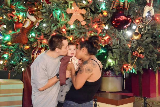 Brittni and Marcus Medina with their 10-month-old son, Micah, at Disney California Adventure. Photo courtesy of Brittni Medina.