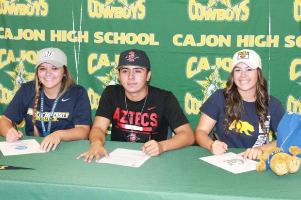 Cajon's Erin Rankin (Averett Univeristy, softball), Devyn Lopez (San Diego State, baseball) and Morgan Zamora-Galloway (Cal, softball) signed national letters of intent Wednesday, Nov. 8. (Photo courtesy of Rich Imbriani, Cajon High School)
