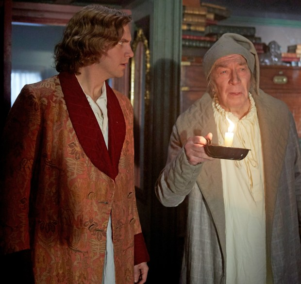 "Dan Stevens as charles Dickens and Christopher Plummer as Ebeneezer Scrooge in ""The Man Who Invented Christmas."""