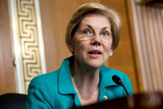 In this Oct. 6, 2015 file photo, Sen. Elizabeth Warren, D-Mass. speaks on Capitol Hill in Washington. Two people with knowledge of Warren's plans say the Massachusetts senator will formally endorse Hillary Clinton for president in the next week or two. They spoke on condition of anonymity Wednesday, June 8, 2016, because they were not authorized to publicly discuss the endorsement before Warren makes it. (AP Photo/Jacquelyn Martin, File)