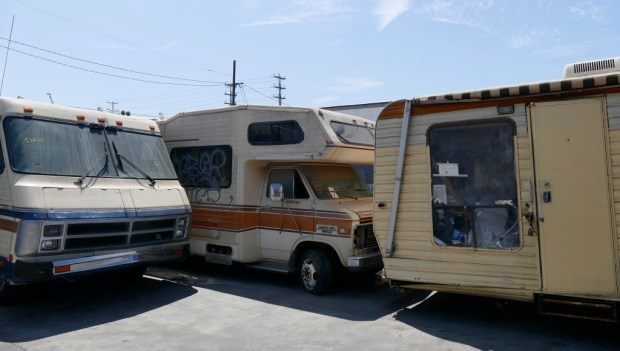 Pepe's Tow Yard in Wilmington is the final resting spot for most of the motor homes formerly used by homeless persons on the streets of Los Angeles. The decrepit, trash-filled, flea ridden and burned-out hulks await the scrapyard or perhaps get auctioned off for as little as $50. (Photo by Brad Graverson/SCNG)