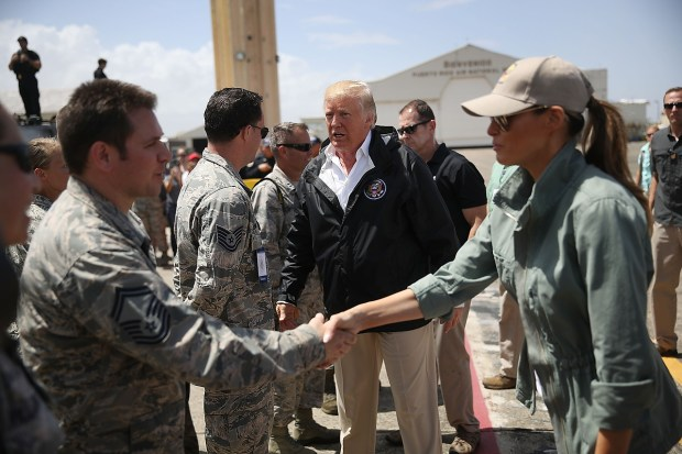 President Donald Trump and Melania Trump greet U.S Air Force airmen as he arrives at the Muniz Air National Guard Base as he makes a visit after Hurricane Maria hit the island on October 3, 2017 in Carolina, Puerto Rico. The President has been criticized by some that say the government's response has been inadequate. (Photo by Joe Raedle/Getty Images)