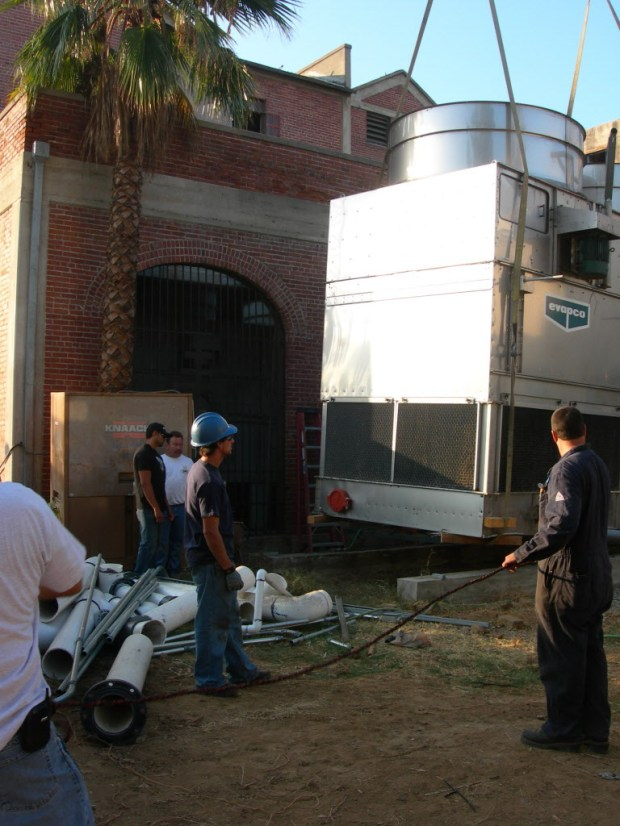 Cooling towers, like this 12,000-pound unit being lifted at Mission Inn Hotel & Spa in Riverside 2007, remove heat from a building. Orange County health officials are investigating towers near the Disneyland resort after an outbreak of Legionnaires' disease. (SCNG file photo)