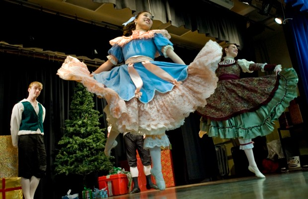 """Megan Yamashita and Elizabeth Chasteler and A.J. Abrams, at left, play the part of children in """"The Nutcracker"""" as part of the Festival Ballet Theatre's outreach program. Photo By Ana Venegas, The Orange County Register"""