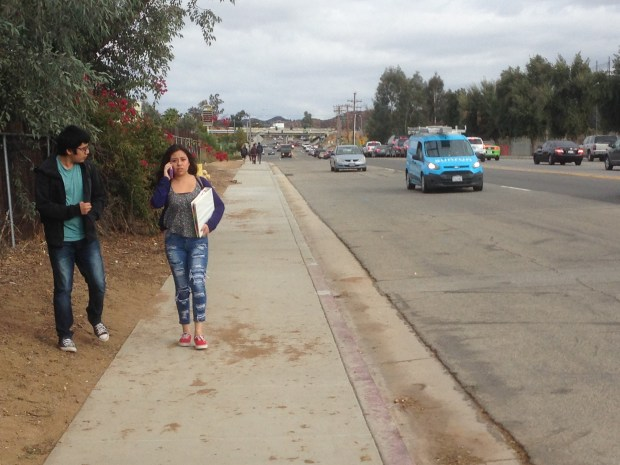 Students leave Elsinore High on Thursday, Nov. 2, after being heldinside past the normal dismissal time because of a scare involving dry ice. Photo by Brian Rokos, Staff
