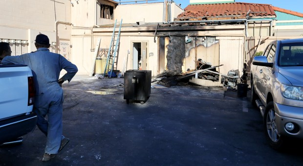 People look at the fire-damaged from a walk-in cooler at Penfold's Café & Bakery on 28250 Old Town Front St in Temecula Wednesday, November 22, 2017. FRANK BELLINO, THE PRESS-ENTERPRISE/SCNG