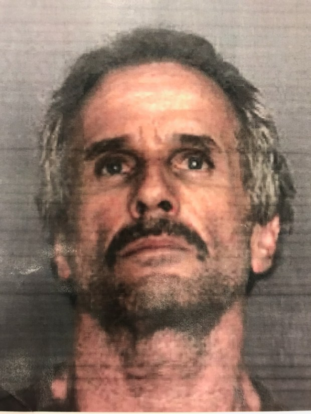 Thomas Sanford Hill, 58, was arrested on suspicion of murder after Upland police say he shot a woman then led authorities on a pursuit that ended near Gorman. (Courtesy Upland Police)