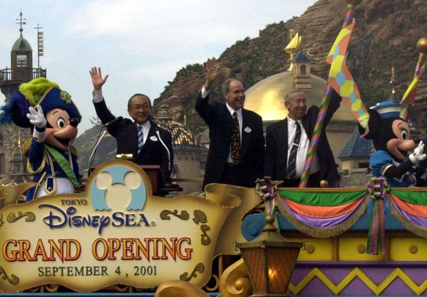Oriental Land Co. President Toshio Kagami, second from left, Walt Disney Co. Chairman and CEO Michael Eisner, center, and Walt Disney Co. Vice President Roy Disney, second from right, wave as they are joined by Mickey Mouse and Minnie Mouse during the grand opening ceremony of Tokyo DisneySea at Urayasu, east of Tokyo, Tuesday, Sept. 4, 2001. The world's first Disney marine theme park is expected to draw up 10 million people a year and repeat the success of nearby Tokyo Disneyland. (AP Photo/Tsugufumi Matsumoto)